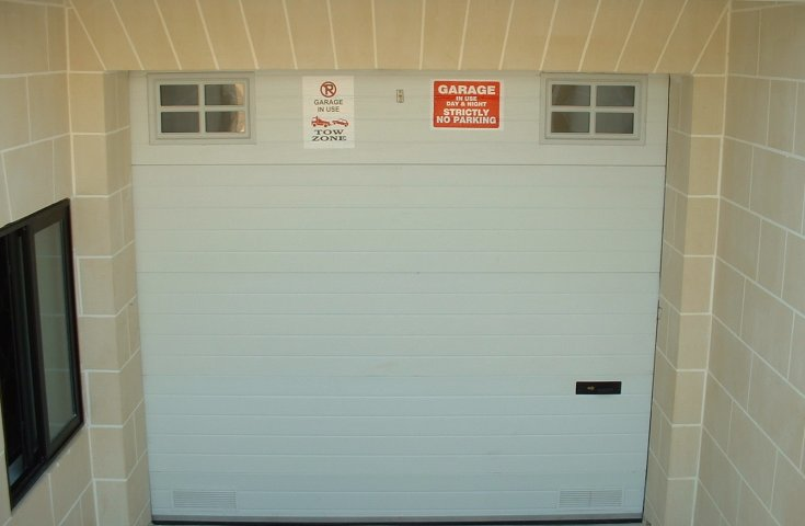 Garage Doors Malta - White sec with 2 windows with two ventilations