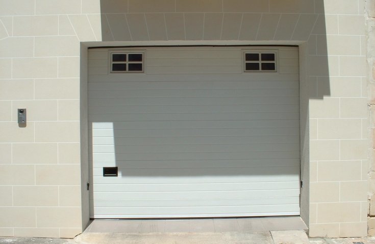 Garage Doors Malta - White sectional with 2 windows